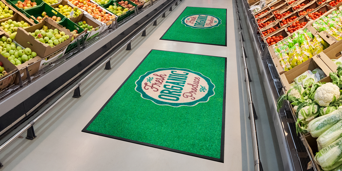 Jet-Print - green Jet-Print mat in the super market advertising the organic food