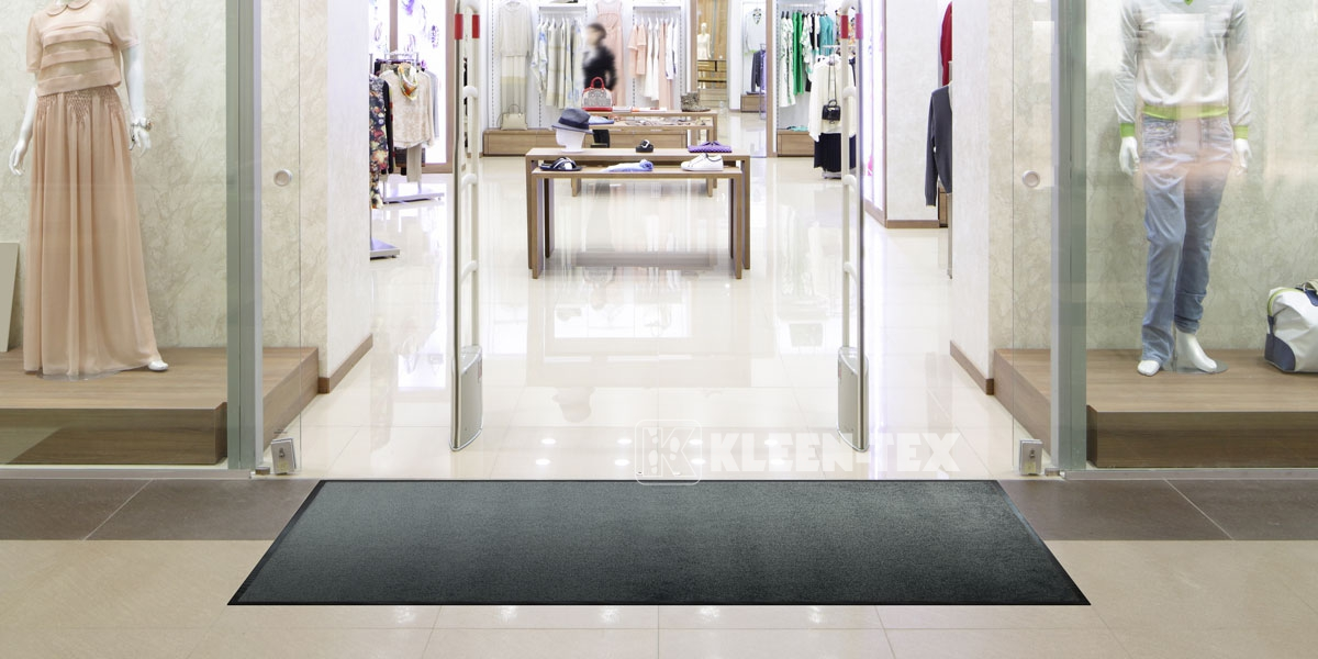 Monotone mat in front of shop entrance