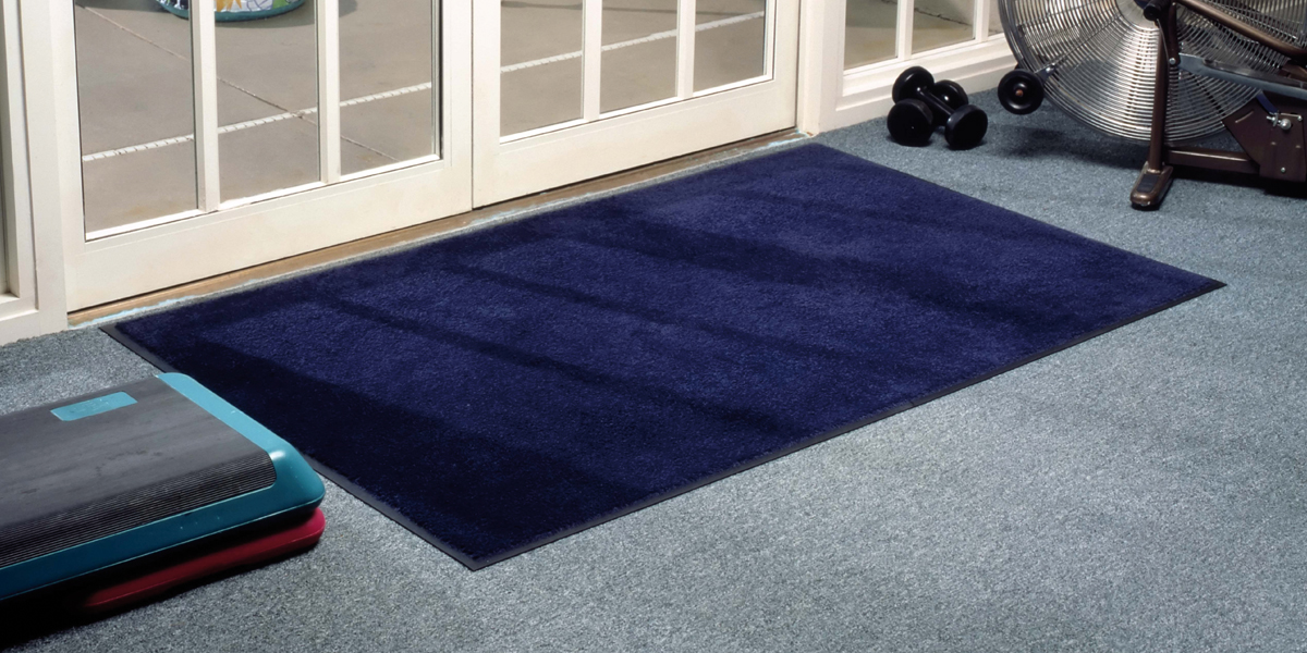 Montone - blue Monotone mat in front of the door